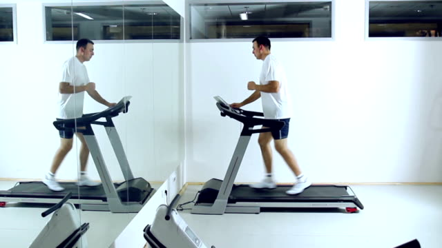 running on treadmill in gym. - stepping stock videos & royalty-free footage