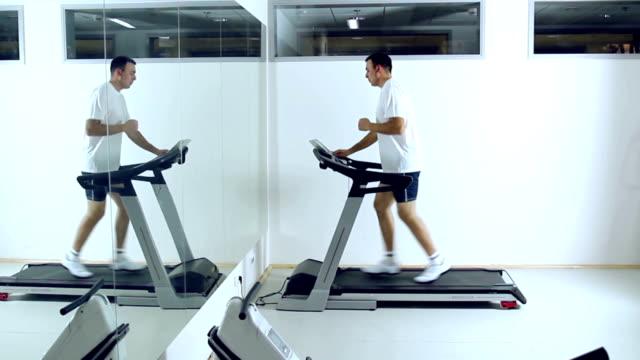 running on treadmill in gym. - treadmill stock videos & royalty-free footage