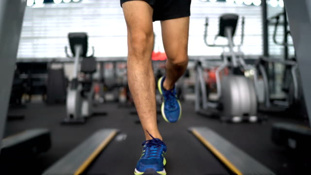 running on treadmill taken from feet to head - treadmill stock videos & royalty-free footage