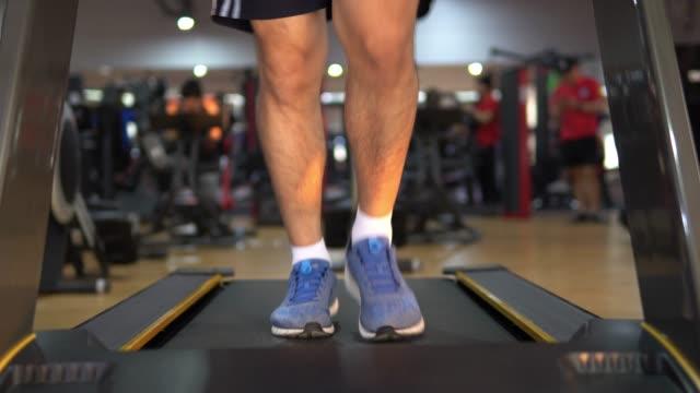 running on treadmill. - treadmill stock videos & royalty-free footage