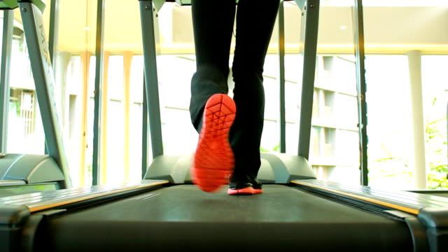 running on treadmill - sports hall stock videos & royalty-free footage