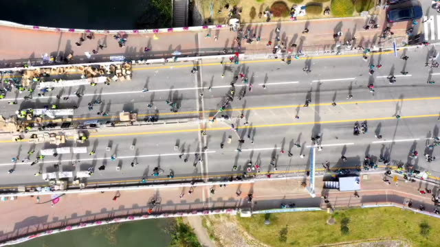 running people at 'chuncheon marathon (chosun ilbo)' event in gongjicheon stream / chuncheon, gangwon-do, south korea - zoom out stock videos & royalty-free footage