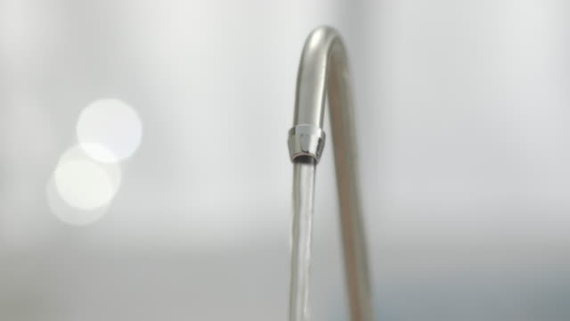 running tap in kitchen. - running water stock videos and b-roll footage