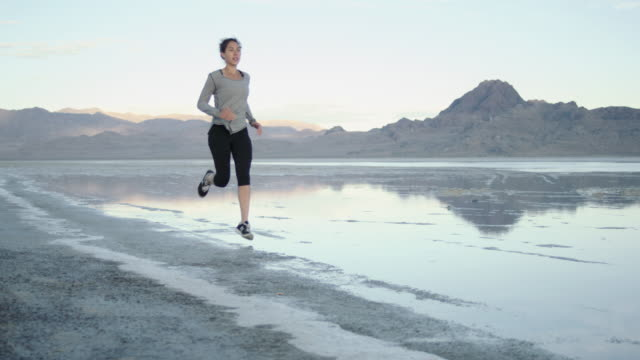 slo mo 4k: running through the mud - bonneville salt flats stock videos & royalty-free footage