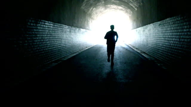 running to the light - tunnel stock videos & royalty-free footage