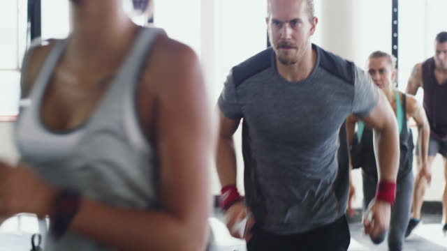 running towards their fitness goals - exercise class stock videos & royalty-free footage