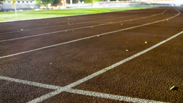 running track night scene - relay stock videos and b-roll footage