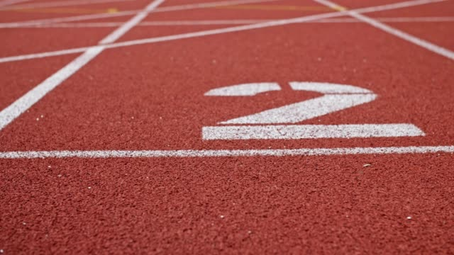 stockvideo's en b-roll-footage met running track met lane two - getal 2