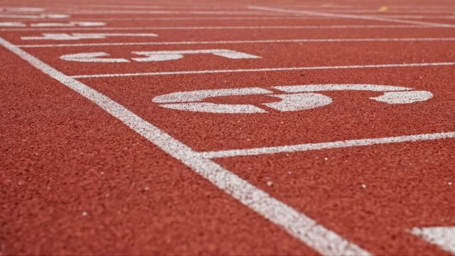 running track with lanes on a stadium - pista di atletica leggera video stock e b–roll