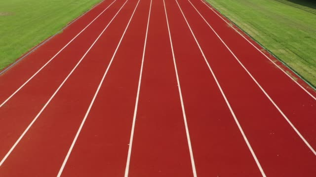 running track with lanes,camera stabilization shot - pista di atletica leggera video stock e b–roll