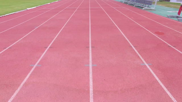 running track with lanes,camera stabilization shot - running track stock videos & royalty-free footage