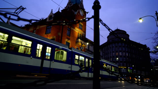 running trams in city center of krakow - trolley bus stock videos & royalty-free footage