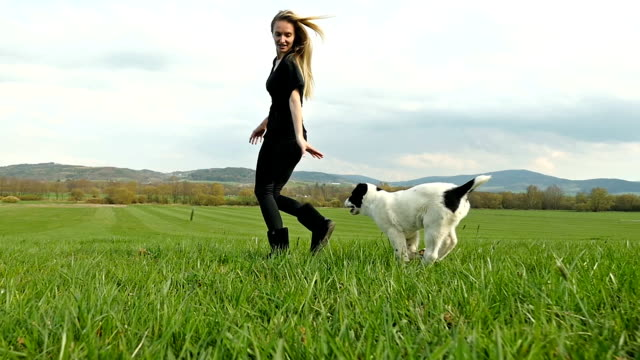 Running with dog friend on field