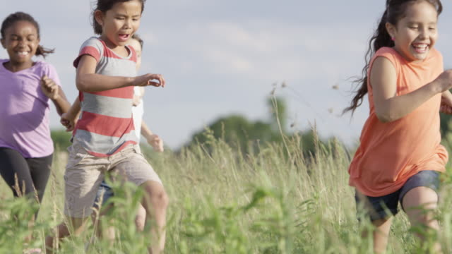 running with friends - children stock videos & royalty-free footage