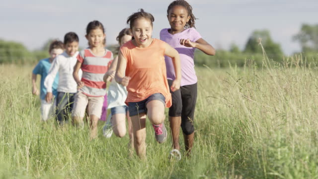 running with friends - primary age child stock videos and b-roll footage