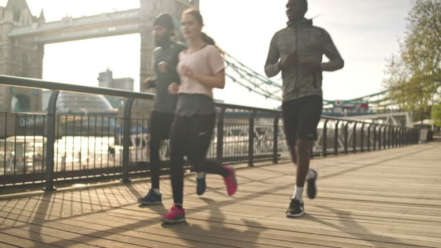 running with friends - city life stock videos & royalty-free footage