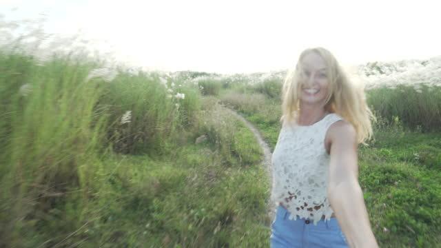 POV running with woman through garden