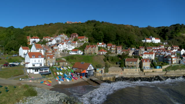 runswick bay cliffside houses, runswick bay, north yorkshire, england - panoramic stock videos & royalty-free footage