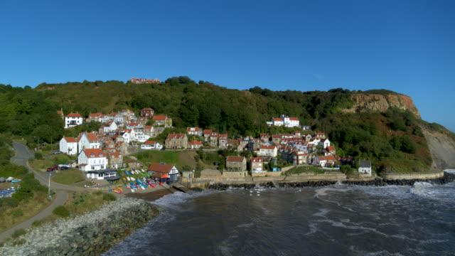runswick bay cliffside houses, runswick bay, north yorkshire, england - dinghy stock videos & royalty-free footage