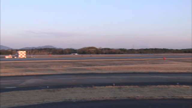 A runway at the Ibaraki Airport has no activity early on the day that the airport opens.