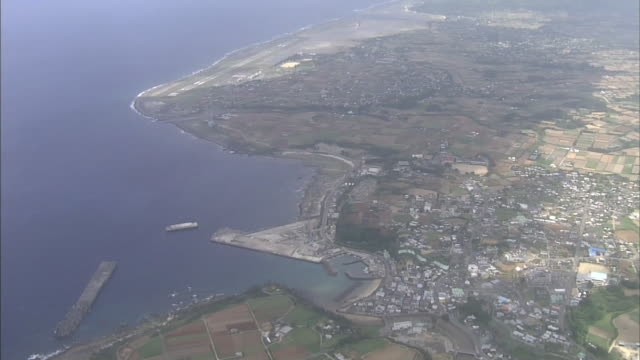 A runway lines the coast near the residential neighborhood of Amagi Town on Tokunoshima Island.