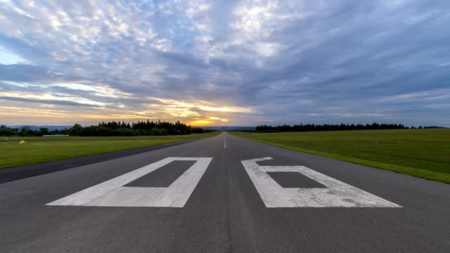 Runway on airfield at sunrise, Wasserkuppe, Gersfeld, Rhon Mountain Range, Hesse, Germany