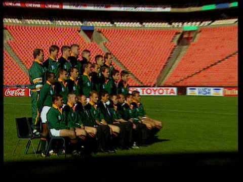 stockvideo's en b-roll-footage met rupert murdoch signs television deal for southern hemisphere rugby s africa johannesburg springboks team photocall on pitch zoom in ditto cms side... - 1995