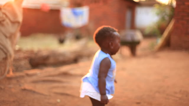 rural african baby learning to walk - africa stock videos & royalty-free footage