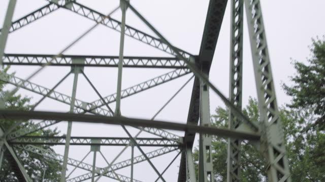 rural bridge crossing, steel bridge drive across - small town stock videos & royalty-free footage