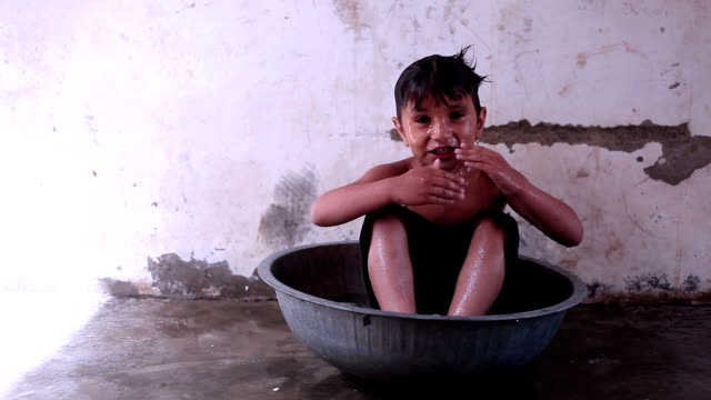 Rural child bathing