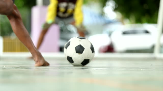 rural children are playing football in a village, thailand, slow motion, defocused - international team soccer stock videos & royalty-free footage