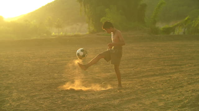 rural children are playing football in the sunshine day in a village. - match sport stock videos & royalty-free footage