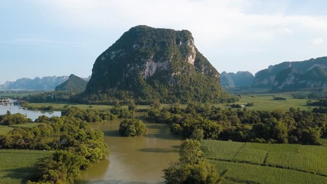 rural chinese landscape of limestone rocks and scenic river around rice fields in guangxi province - guilin stock videos & royalty-free footage