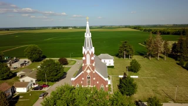 rural church steeple aerial pan - steeple stock videos & royalty-free footage