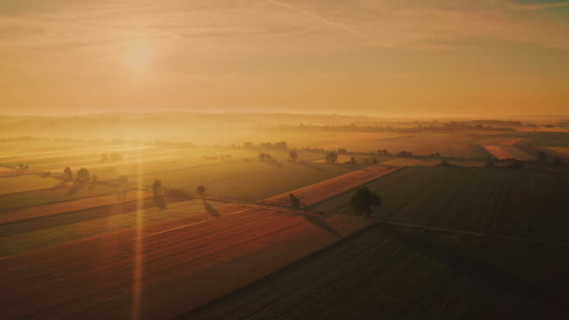 aerial rural countryside at sunset - wide shot stock videos & royalty-free footage