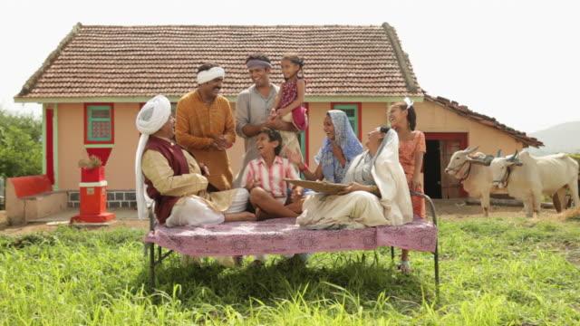 rural family enjoying  - turban stock videos & royalty-free footage