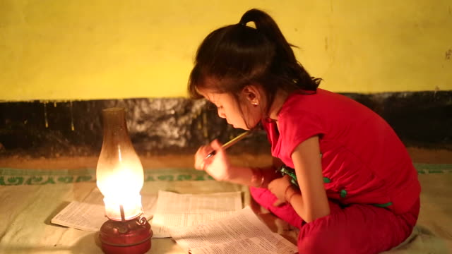 stockvideo's en b-roll-footage met rural girl studying in lantern - meisjes