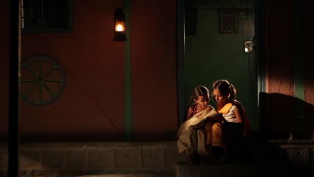 Rural girls studying at night
