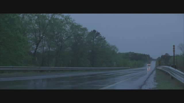 ms, rural highway in rain - anamorphic stock videos & royalty-free footage
