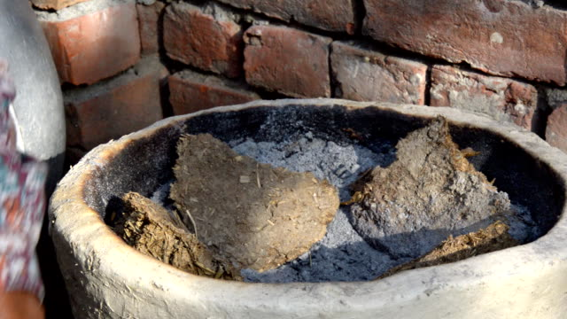 rural indian cooking process using cow dung cakes - dung stock videos & royalty-free footage