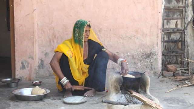 rural indian woman rolling dough - india stock videos & royalty-free footage