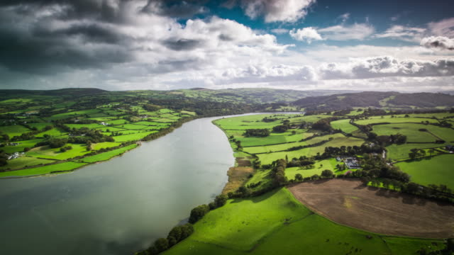 aerial: rural landcape in wales, uk - valley stock videos & royalty-free footage
