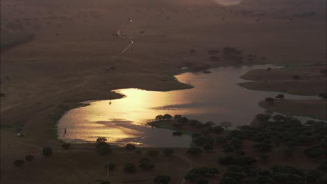 aerial ws td rural landscape at sunset with reflections in lake / evora, portugal - évora district stock videos & royalty-free footage