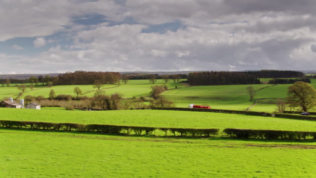 rural landscape in northumbria, england - aerial shot - rural scene stock videos & royalty-free footage