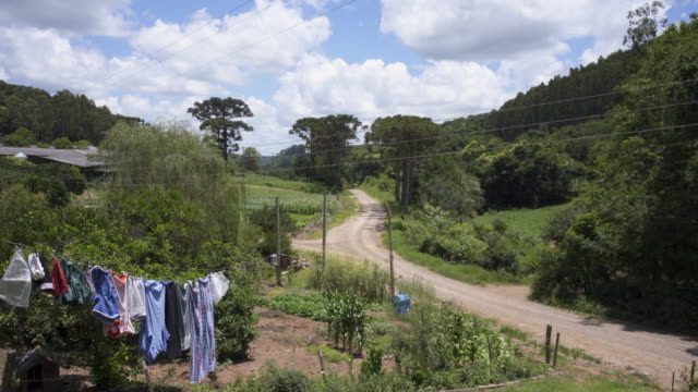 a rural landscape in southern brazil with washing on the farmhouse line. - clothesline stock videos & royalty-free footage