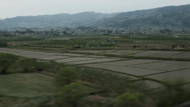 POV Rural landscape seen from bullet train, Japan