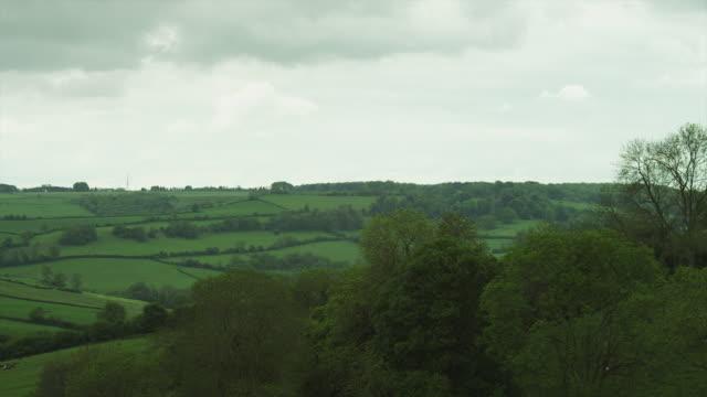 ws pan rural landscape / somerset, uk - somerset england stock-videos und b-roll-filmmaterial