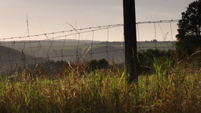 crane up: rural landscape - chainlink fence stock videos and b-roll footage
