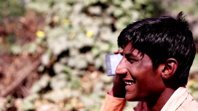 Rural men talking on mobile phone
