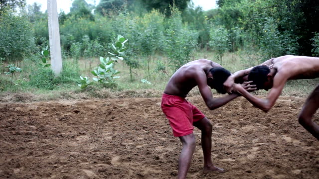 rural mud wrestling in india - competition stock videos & royalty-free footage